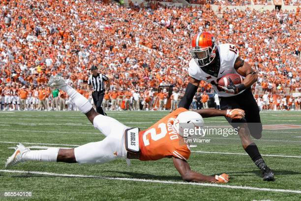 Chris Lacy of the Oklahoma State Cowboys avoids a tackle by Kris Boyd of the Texas Longhorns in the second half at Darrell K RoyalTexas Memorial...