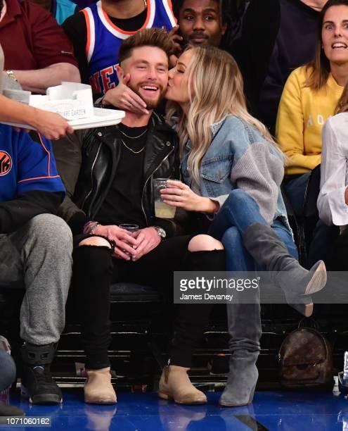 Chris Lane and Lauren Bushnell attend Charlotte Hornets v New York Knicks game at Madison Square Garden on December 9 2018 in New York City