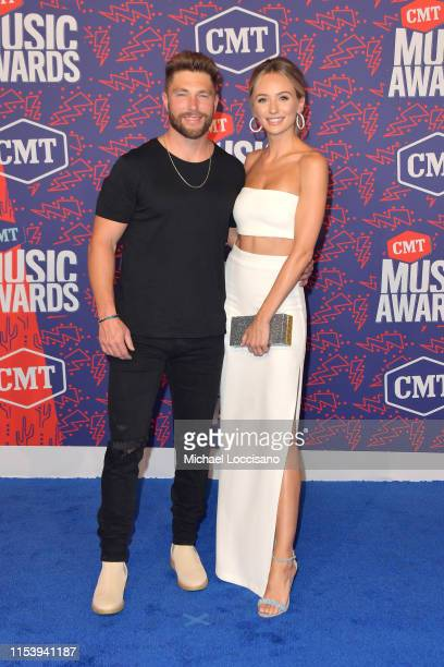 Chris Lane and Lauren Bushnell attend the 2019 CMT Music Awards at Bridgestone Arena on June 05 2019 in Nashville Tennessee