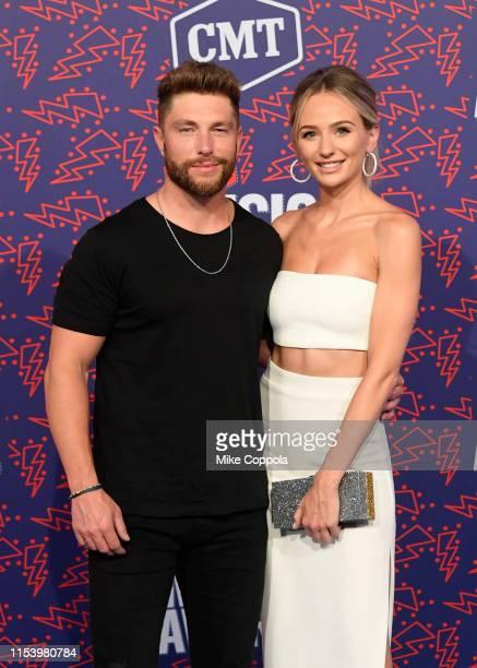 Chris Lane and Lauren Bushnell attend the 2019 CMT Music Awards at Bridgestone Arena on June 05 2019 in Nashville Tennessee
