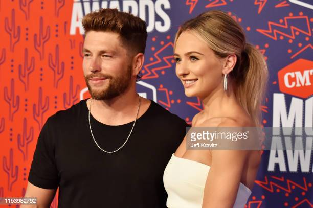 Chris Lane and Lauren Bushnell attend the 2019 CMT Music Awards Arrivals at Bridgestone Arena on June 05 2019 in Nashville Tennessee