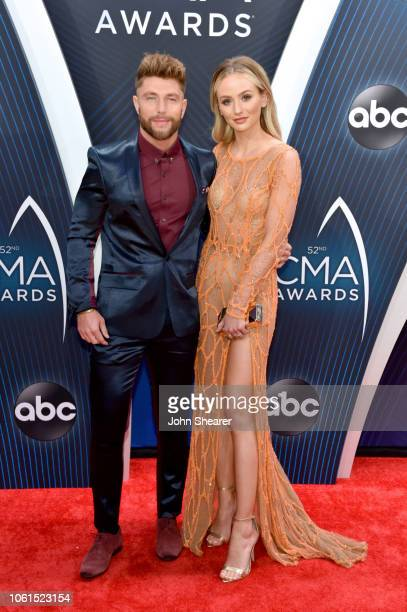 Chris Lane and Lauren Bushnell attend the 52nd annual CMA Awards at the Bridgestone Arena on November 14 2018 in Nashville Tennessee