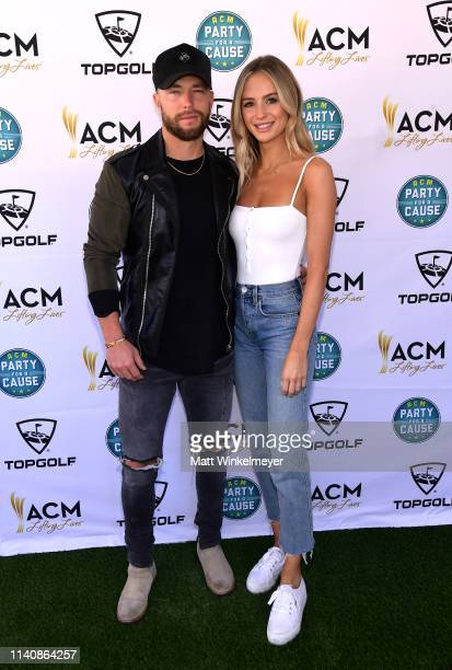 Chris Lane and Lauren Bushnell attend the ACM Lifting Lives TOPGOLF TeeOff at TOPGOLF on April 06 2019 in Las Vegas Nevada