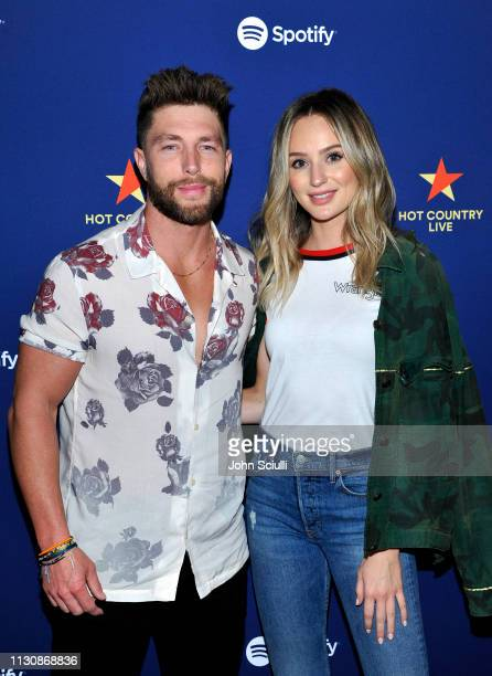 Chris Lane and Lauren Bushnell pose for a photo backstage at Spotify's Hot Country Live Presents Florida Georgia Line at The Wiltern on February 19...