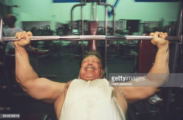 Chris Langan bouncer and one of the smartest people in the world works out with weights in a gym in Long Island