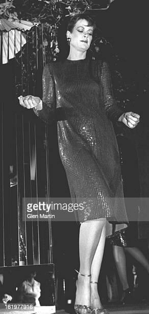 MAR 20 1982 MAR 25 1982 Chris Lange of Dallas in Akira's solidlypaved dress