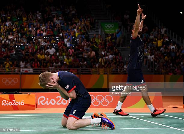 Chris Langridge and Marcus Ellis of Great Britain celebrate winning match point against Wei Hong and Biao Chai of China during the Men's Doubles...