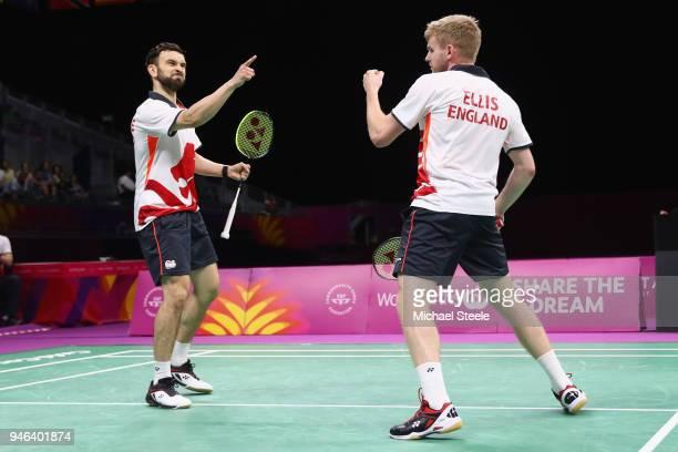 Chris Langridge of England celebrates a point with doubles partner Marcus Ellis during the men's doubles final match against Chirag Chandrashekhar...