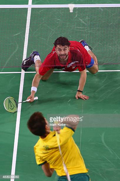 Chris Langridge of England playing with his partner Peter Mills of England watches from the ground as Raymond Tam of Australia returns a shot as they...
