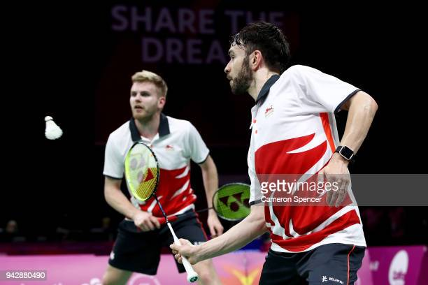 Chris Langridge of England plays a shot with team mate Marcus Ellis of England during the Badminton Mixed Team Quarterfinal against Jason HoShue and...