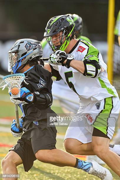 Chris LaPierre of the New York Lizards defends against the Ohio Machine on July 18 2015 at Selby Stadium in Delaware Ohio