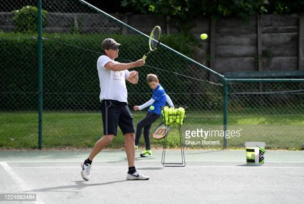 Chris Laskowski coaches his Oskar at Northampton County Lawn Tennis Club on May 13, 2020 in Northampton, United Kingdom. The prime minister announced...