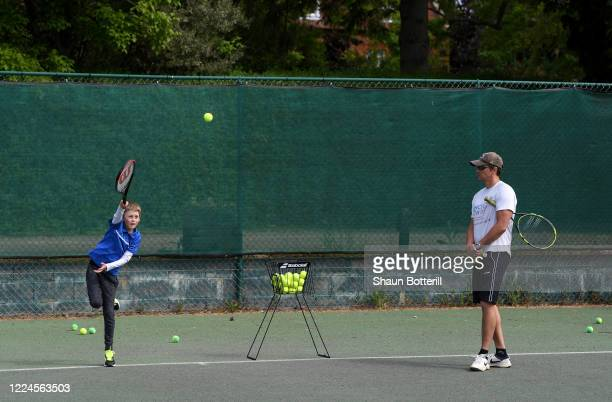 Chris Laskowski coaches his Oskar at Northampton County Lawn Tennis Club on May 13 2020 in Northampton United Kingdom The prime minister announced...