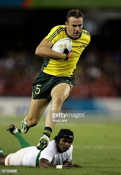 Chris Latham of Australia gets past the Sri Lankan defence during the rugby sevens match between Australia and Sri Lanka at the Telstra Dome on day...