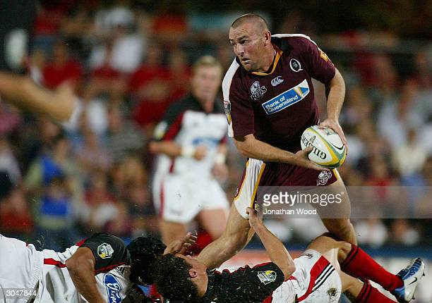 Chris Latham of the Reds looks to get a pass away during the Super 12 Match between the Queensland Reds and Crusaders played at Ballymore Stadium...