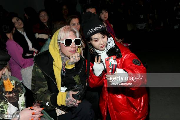 Chris Lavish and a guest attend the Irina Vitjaz front row during New York Fashion Week The Shows at Gallery I at Spring Studios on February 14 2018...