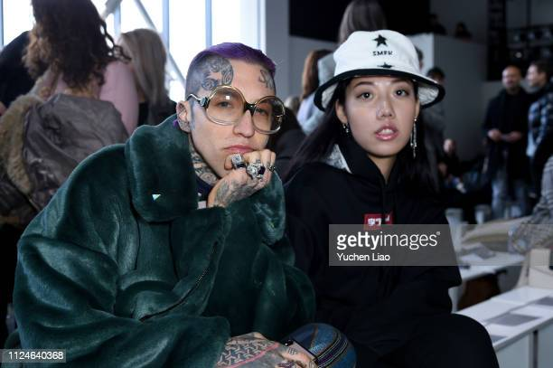 Chris Lavish and Michelle Song attend the Calvin Luo front row during New York Fashion Week The Shows at Gallery I at Spring Studios on February 13...