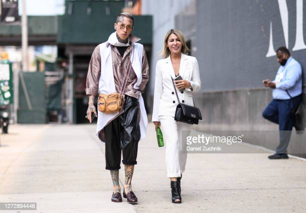Chris Lavish and Olga Ferrara are seen outside the Studio 189 show during New York Fashion Week S/S21 on September 16, 2020 in New York City.