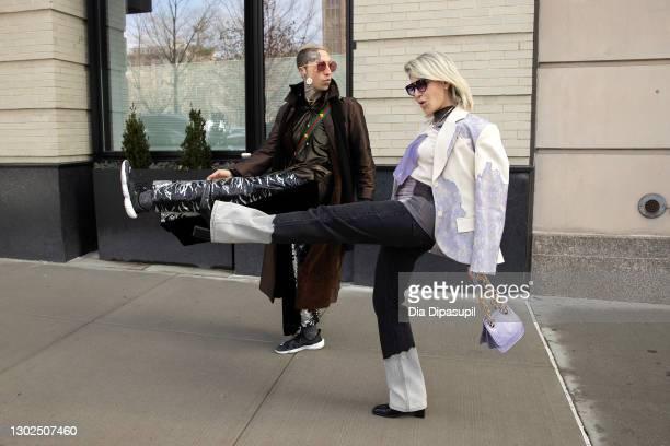 Chris Lavish and Olga Ferrara attend New York Fashion Week at Spring Studios on February 16, 2021 in New York City.