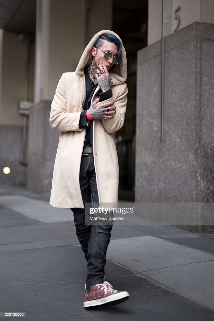 Chris Lavish is seen attending New York Mens Day at Dune Studios wearing Masoni shoes, Aking jeans, vintage coat and Gentle Monster sunglasses on January 30, 2017 in New York City.