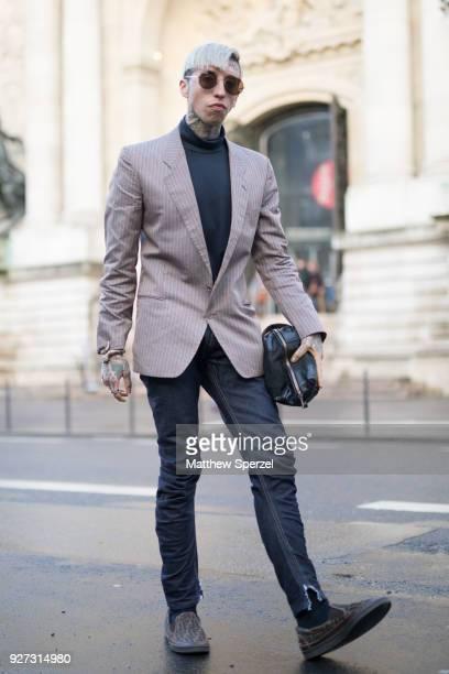 Chris Lavish is seen on the street attending John Galliano during Paris Women's Fashion Week A/W 2018 wearing Giorgio Armani blazer IÕlli sunglasses...