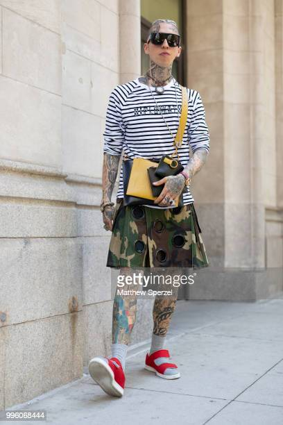 Chris Lavish is seen on the street attending Men's New York Fashion Week wearing Diplomacy shirt Friedman kilt by Mickey Moschino glasses Versace...