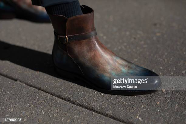 Chris Lavish is seen on the street during Men's New York Fashion Week wearing WarDog green fur coat Balenciaga glasses JMLegazel shoes on February 04...