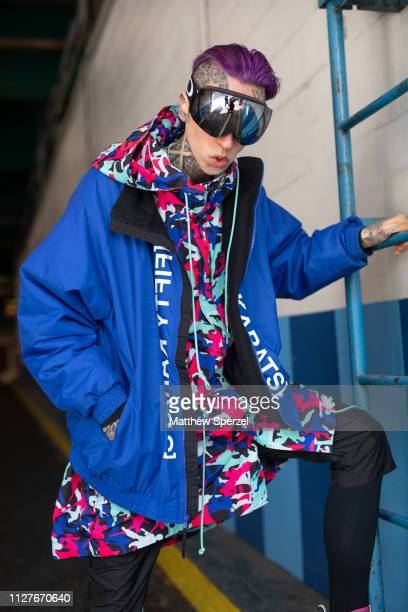 Chris Lavish is seen on the street during Men's New York Fashion Week wearing Fifty Karats jacket Swear London shoes and Defyant hoodie on February...