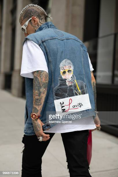 Chris Lavish is seen on the street during Men's New York Fashion Week wearing custom vest and shoes on July 11 2018 in New York City