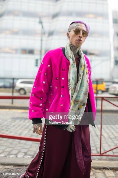Chris Lavish is seen on the street during New York Fashion Week AW19 wearing Laurence Chico pink coat and merlot pants on February 07 2019 in New...