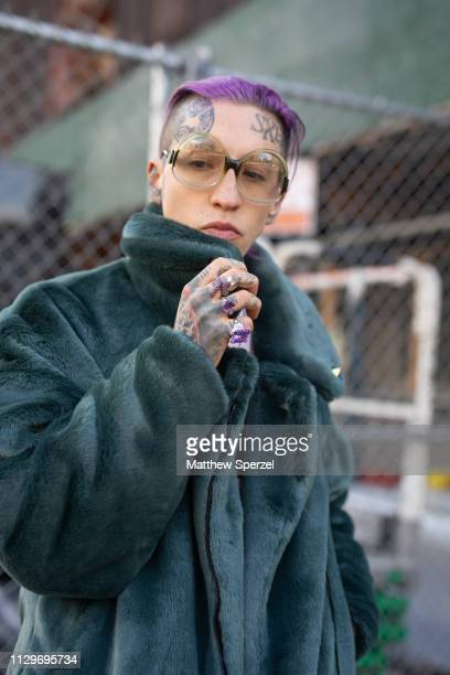 Chris Lavish is seen on the street during New York Fashion Week AW19 wearing sea green fur coat navy pants and purple rings on February 13 2019 in...