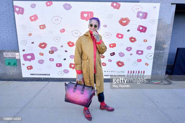Chris Lavish poses in front of the Maybelline New York Mural outside of NYFW The Shows during New York Fashion Week The Shows at Spring Studios on...