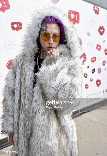 Chris Lavish poses in front of the Maybelline New York Mural outside of New York Fashion Week The Shows at Spring Studios on February 10 2019 in New...