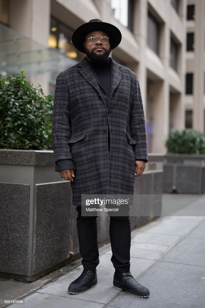 Chris Lawrence is seen attending NYFW Men's Day at Dune Studios wearing Gorman Brothers hat, Perry Ellis Coat, Asos blazer, Cheap Monday pants, and Jimmy Choo shoes on January 30, 2017 in New York City.
