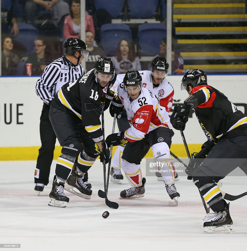 Chris Lawrence #18 of Nottingham Panthers and Karl Fabricius # 52 of Lulea compete during the Champions Hockey League group stage game between Nottingham Panthers and Lulea Hockeyat at the National Ice Centre on August 24, 2014 in Nottingham, England.