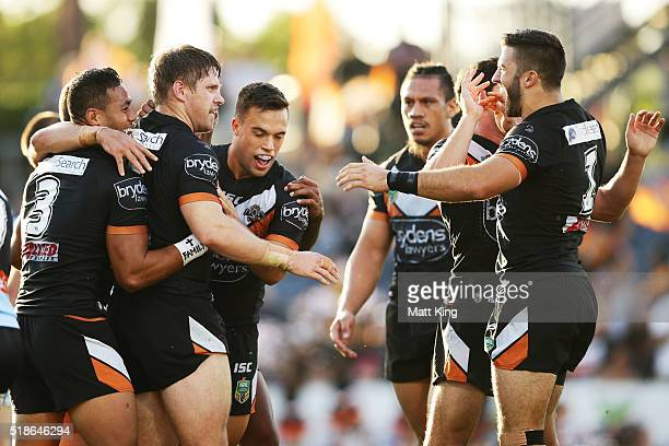 Chris Lawrence of the Tigers celebrates with team mates after scoring a try during the round five NRL match between the Wests Tigers and the Cronulla...
