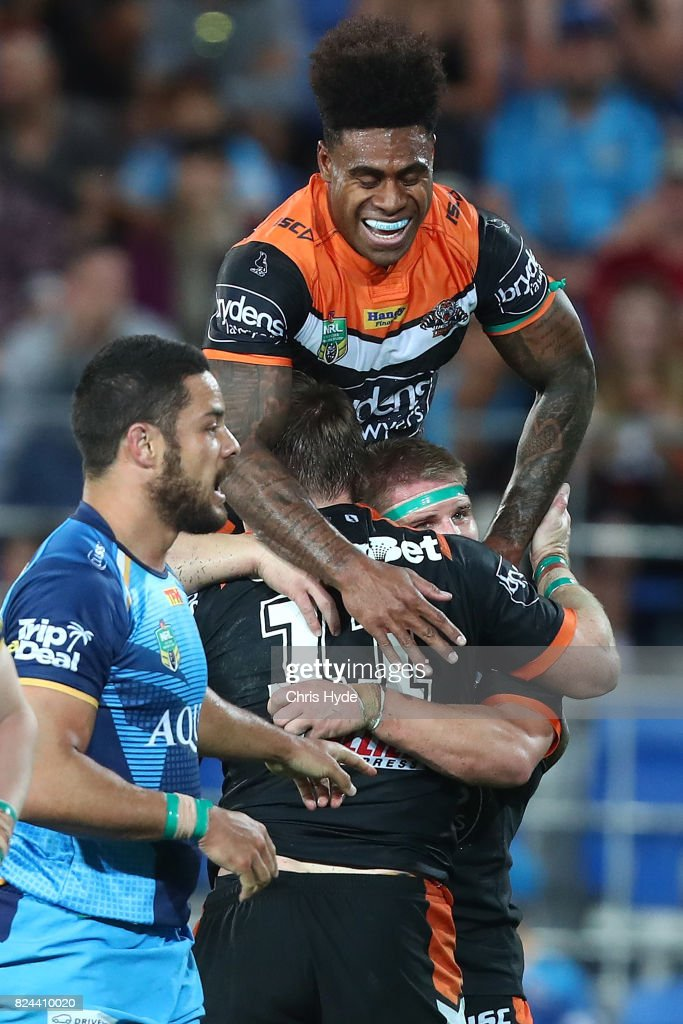 Chris Lawrence of the Tigers celebrates with team mates after scoring a try during the round 21 NRL match between the Gold Coast Titans and the Wests Tigers at Cbus Super Stadium on July 30, 2017 in Gold Coast, Australia.