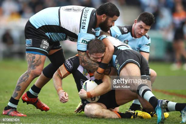 Chris Lawrence of the Tigers is tackled during the round 14 NRL match between the Cronulla Sharks and the Wests Tigers at Southern Cross Group...