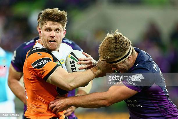 Chris Lawrence of the Tigers is tackled during the round 16 NRL match between the Melbourne Storm and Wests Tigers at AAMI Park on June 26 2016 in...