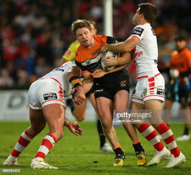 Chris Lawrence of the Tigers is tackled during the round 18 NRL match between the St George Illawarra Dragons and the Wests Tigers at UOW Jubilee...