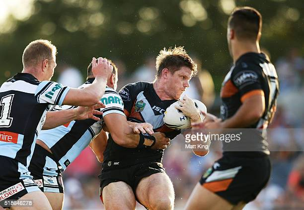 Chris Lawrence of the Tigers is tackled during the round five NRL match between the Wests Tigers and the Cronulla Sharks at Campbelltown Sports...