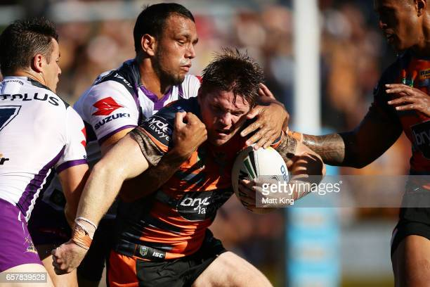 Chris Lawrence of the Tigers is tackled during the round four NRL match between the Wests Tigers and the Melbourne Storm at Leichhardt Oval on March...