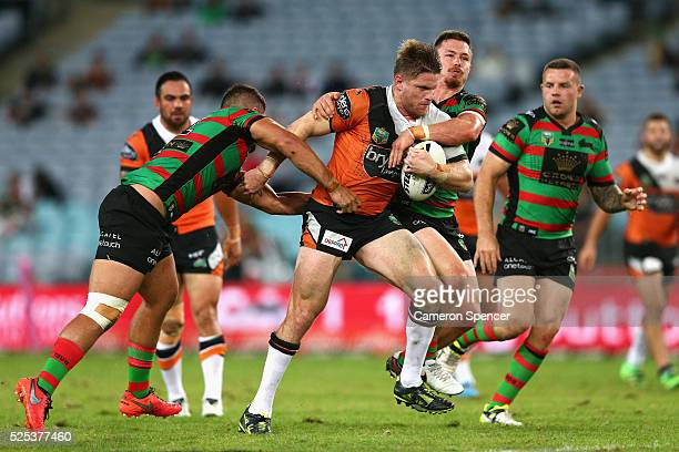 Chris Lawrence of the Tigers is tackled during the round nine NRL match between the South Sydney Rabbitohs and the Wests Tigers at ANZ Stadium on...