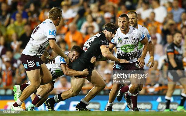 Chris Lawrence of the Tigers is tackled during the round two NRL match between the Wests Tigers and the Manly Sea Eagles at Leichhardt Oval on March...
