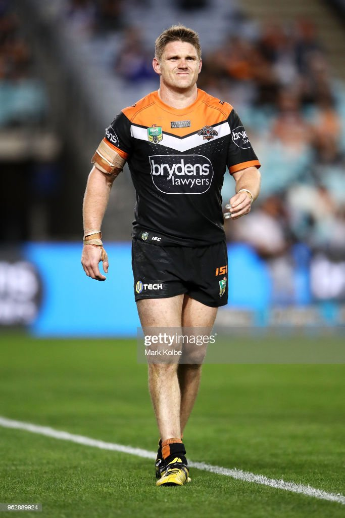 Chris Lawrence of the Tigers leaves the field with an injury during the round 12 NRL match between the Wests Tigers and the Canterbury Bulldogs at ANZ Stadium on May 27, 2018 in Sydney, Australia.