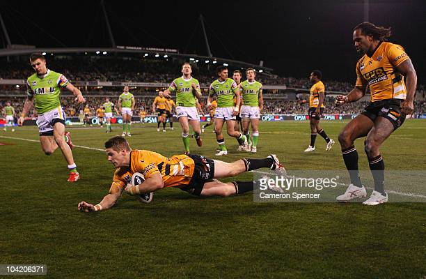 Chris Lawrence of the Tigers scores a try during the first NRL semi final match between the Canberra Raiders and the Wests Tigers at Canberra Stadium...