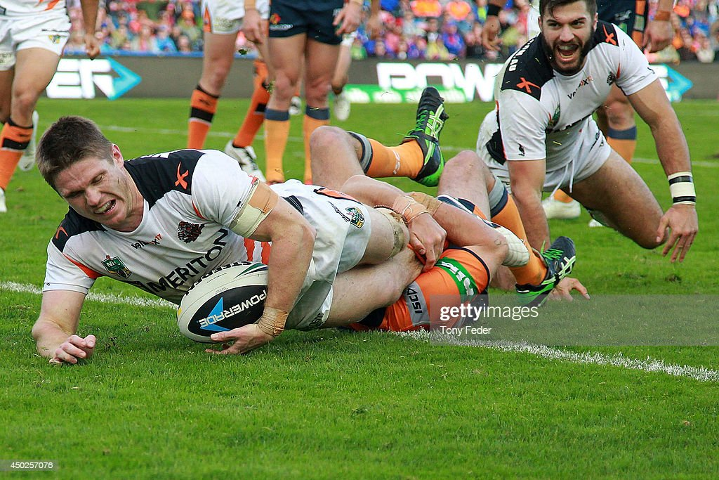 Chris Lawrence of the Tigers scores a try during the round 13 NRL match between the Newcastle Knights and the Wests Tigers at Hunter Stadium on June 8, 2014 in Newcastle, Australia.