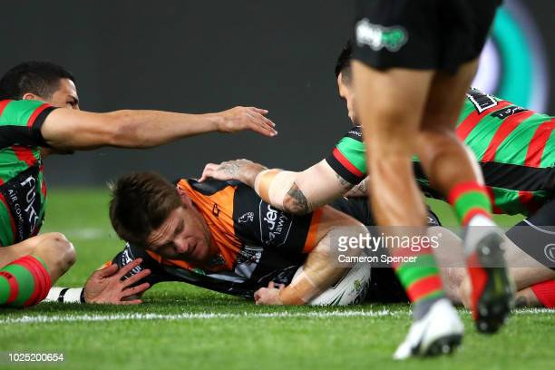 Chris Lawrence of the Tigers scores a try during the round 25 NRL match between the South Sydney Rabbitohs and the Wests Tigers at ANZ Stadium on...