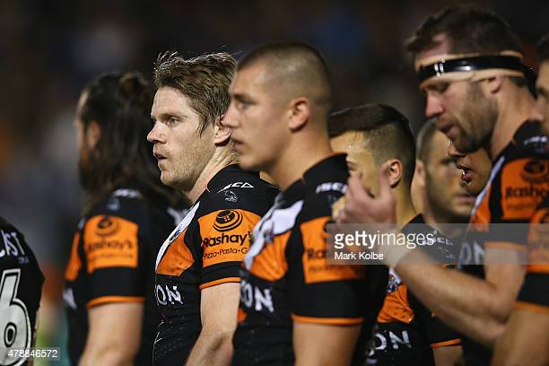 Chris Lawrence of the Wests Tigers looks dejected after a Panthers try during the round 16 NRL match between the Wests Tigers and the Penrith...