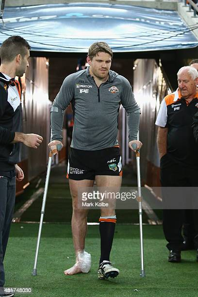 Chris Lawrence of the Wests Tigers walks out of the tunnel to sit on the bench after leaving the field with an injury during the round 20 NRL match...